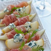 Prosciutto wrapped pears with blue cheese crumbles