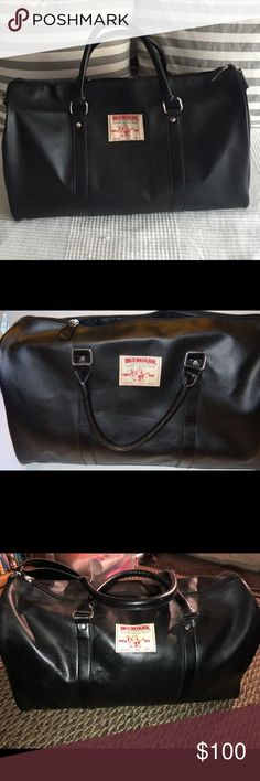 "Black Faux leather True Religion traveler Excellent NEW Condition - Never Used!  True Religion Jeans Fragrance Faux Leather Bag  18"" by 11"" high  Shoulder straps /silver accents True Religion Bags Travel Bags"