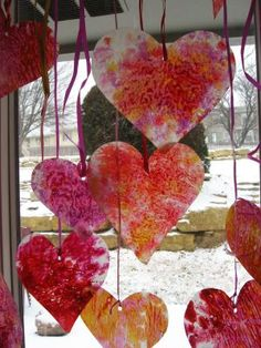 "Valentine's Day decor craft: crayon ""stained glass"" hearts. Cute kids party decor or party activity."