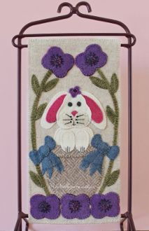 """Ms. Violet Bunny Banner Pattern by Woolkeeper at KayeWood.com. This 6"""" x 12"""" banner features Ms. Violet Bunny and her bright spring flowers.  Beautiful threads in bright colors embellish the blooms.  http://www.kayewood.com/Ms-Violet-Bunny-Banner-Pattern-by-Woolkeeper-WK-MSVI.htm $10.00"""
