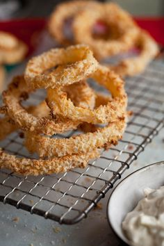 Close up mmmmmmmm -crispy oven roasted onion rings with a jalepeno dip-