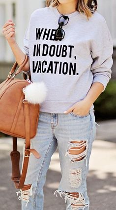 Distressed denim + sweatshirt.