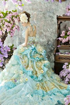 Stella de Libero . nice overdone flower/ruffles... however I find the level of skinnyness of the model simply awful!!