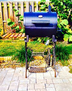 An old Singer sewing machine base turned into a grill.