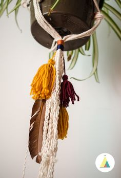 Les Gertrudes. Macrame plant hanger. Macrame hangers. Bohemian support. Wool tassels and feathers. Handmade in Montreal. Macrame planters.
