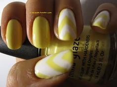 yellow and white chevron nails