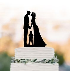 Bride and groom wedding cake topper with boy by TopperDesigner