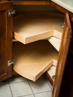 Lower Corner Cabinet W/lazy Susan, But Have Door Attached To The Susan So  You Push The Door To Turn The Susan.