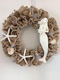 A personal favorite from my Etsy shop https://www.etsy.com/listing/533499975/mermaid-wreath-with-shells-and-mermaid