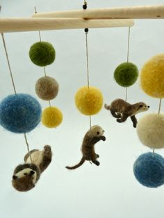 @Stacy Asdell, could you just pass out from this CUTENESS! It made me think of you... Otter Mobile, Baby Mobile, Animal Mobile, Unique Nursery, Yellow, Blue, Green.