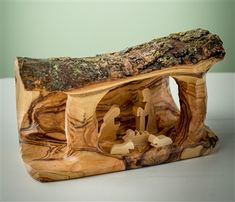 hand-crafted olive wood grotto made in Bethlehem - http://www.earthwoodproducts.com/Default.asp