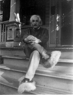 Albert Einstein wearing fuzzy slippers, sitting on the front steps of his home in Princeton | by Gillett Griffin, circa 1950