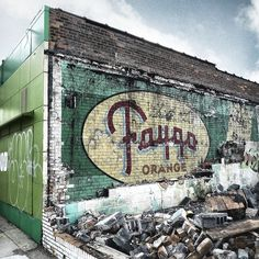 Faygo Orange Pop!    Old Faygo sign found in Highland Park, Michigan after they tore down the building next door, had to go see it for myself today, love hidden treasures like this!