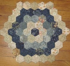 Paper pieced hexagons by Barbara Brackman