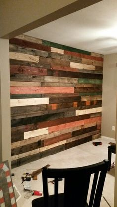 Multi colored stained pallet wall