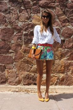 printed shorts and a white blouse