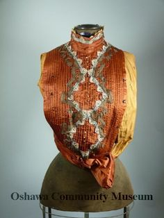 Sleeveless blouse, rust and brown