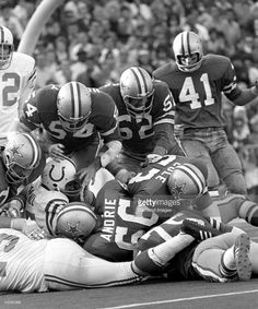 Linebacker Chuck Howley #54, of the Dallas Cowboys, helps George Andrie #66, Larry Cole #63, Dave Edwards #52 and Charlie Waters #41 stop Earl Morrall #15 on a quarterback sneak at the goal line during Super Bowl V on January 17, 1971 against the Baltimore Colts at the Orange Bowl in Miami, Florida.