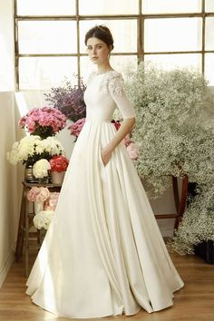 Ivory silk ball gown with pearl sequined sleeves and pearl drops embroidery
