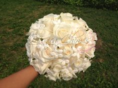 Wedding all white bouquet with white roses and stephanotis with crystals.
