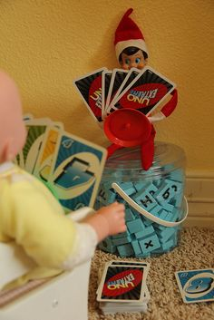 A friendly game of cards with Elf on the Shelf.