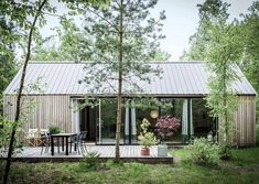 Barnhouse Cabin — The south facing facade and the deck captured by ...
