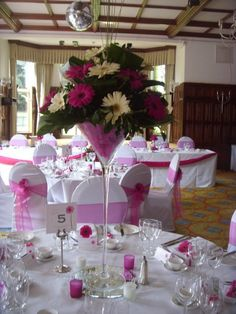 Tall martini vase in cerise and white with gerberas in a modern style x
