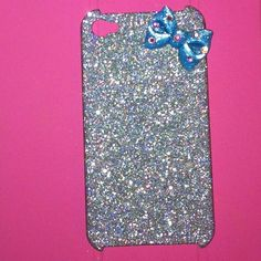 Silver glitter phone case with blue sparkley bow