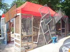 Old Screen doors and window screens on tent  byTexas Trash and Treasures