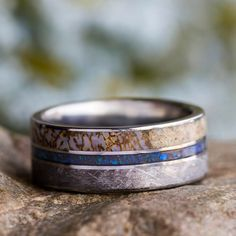 Even men can wear opal, this meteorite and dinosaur bone ring is handmade and is inlaid with crushed opal in the center. It has a smooth and comfortable ...