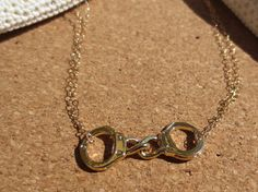 SALE going on now!! 15% off use code etsy15   handcuff charm necklace by PanachebyAmanda on Etsy, $27.20