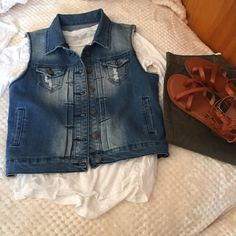 Denim vest size small Worn once, great with almost any outfit. Sitting in closet. Needs a new home. From pet and smoke free home. Jackets & Coats Vests