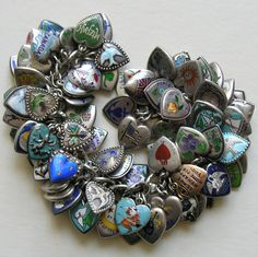 A collection of rare and very hard to find enameled antique and Victorian heart charms.
