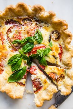 Combining a creamy egg base with heirloom tomatoes, fresh basil, a shaving of Parmigiano-Reggiano, and onions caramelized to perfection, this is the be-all end-all of quiche recipes. Quiche Recipes, Brunch Recipes, Summer Recipes, Dinner Recipes, Picnic Recipes, Parmigiano Reggiano, Heirloom Tomatoes, Slow Food, Fresh Basil