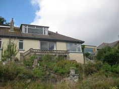 60s bungalow makeover. We removed the roof, gutted the inside and then.........