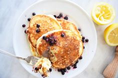 Lemon Blueberry Ricotta Pancakes are the softest, fluffiest, and most delicious pancake creation around!