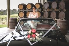 Mustangs in Black 1966 GT Convertible Ford Mustang at Two Brookes Bar and Bistro for a styled wedding shoot organised by Wedding Services Melbourne. Flowers by Wedding Flowers Etc. Dress by Thafnis Dressmaking. Hair & MUA by Ava Jane.