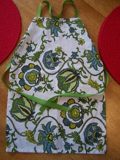 Place Mat Kid Apron... This fits kids 18 mos to 2 years. If you have an older or larger child, you'll have to find something bigger... say a large dish towel. Make sure to wash before sewing as most cotton place mats and dish towels shrink.