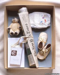 A time capsule, made in an archival box lined with acid-free paper, can hold your baby's most precious items, from the first pair of baby shoes to disposal diapers. Include important memories too -- photos, videos, and a laminated front page of a local newspaper.