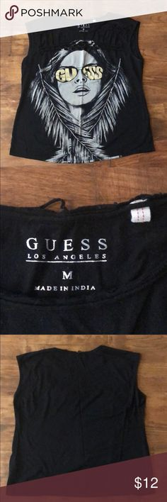 Guess shirt for women Pre owned Guess shirt for women. Size M. Shows some signs of wear. Under arms and back. No damages. The shirt had a distressed look to it not worn out. Price reflects the usage Guess Tops Blouses