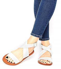 The Season's Coolest Flat Sandals via @WhoWhatWear