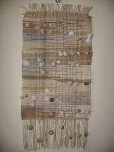 Saori weaving using strings of shells woven in. love it ! Know I know what to do with the shell collection.