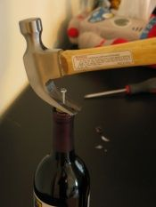 How to open a wine bottle without a corkscrew.
