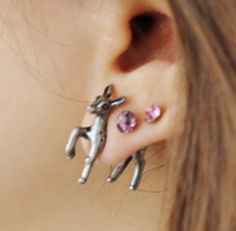 """Unique """"3D Deer"""" Pierced Earrings. It appears as if the deer is coming out of your earlobe ! Amazing !! Let this funky earring makes a great gift for yourself or that special someone.... Color: Grey, Black Material: Metal Alloy, Resin Size: approx. 2.5cm Gender: Unisex Quantity: 1 Pair..."""