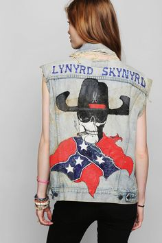 Whaaaaat! Authentic vintage washed, worn, and torn denim vest with a button front and Lynyrd Skynrd painted detail on the back. The most rad. Only one in stock! #urbanoutfitters