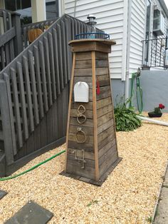 Lighthouse mailbox. We made this for my sister, it looks great in her front yard!