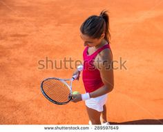 Young woman playing tennis.High angle view. - stock photo