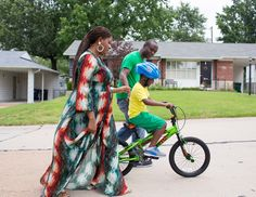 Katina Combs with her husband, Michael, and their son, Michael Jr., near their house in Affton, Mo.,... - Whitney Curtis for The New York Times