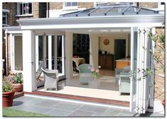 Love the extra nook for the table to allow a seating area infront of doors.Orangery with folding sliding doors Garden Room Extensions, House Extensions, Orangerie Extension, Roof Styles, House Styles, Roof Lantern, Grades, Roof Architecture, Conservatory
