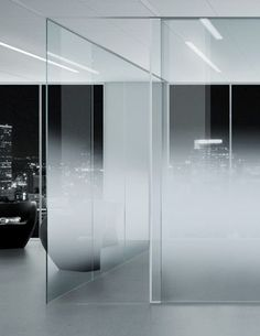| STUDIOS | DETAILS | Office partitions in progressive satin finish glass. Office glass partition wall Ecosat by Vitrealspecchi. - Lovely alternative to standard privacy film, a much more sexier approach. glass privacypartitions studio